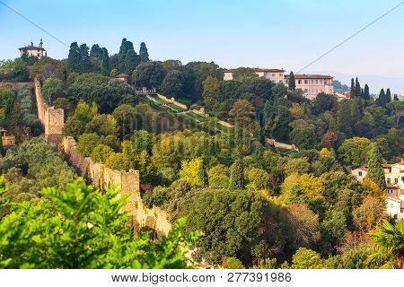 Aerial View Of Historical Medieval Town Of Florence, Italy And Boboli Gardens On The Hill