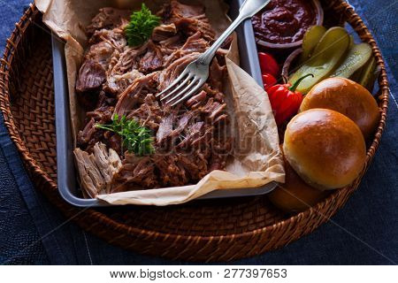 homemade pulled pork with burger  and bbq sauce