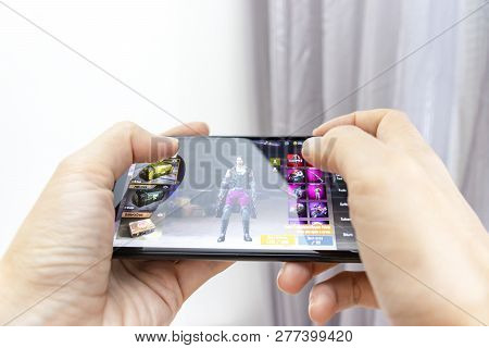 Moscow, Russia - January 08, 2018: Hands Holding A Smartphone With Online Multyplayer Game Pubg Mobi