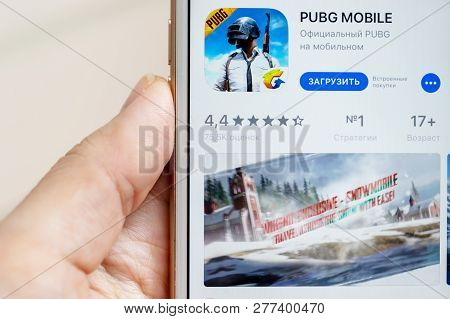 Moscow, Russia - January 08, 2018: Hands Holding Apple Iphone 7s With Online Multyplayer Game Pubg M