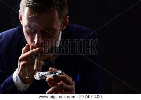 Spending Much Money On Foolish Pleasures. Man Light Up Cigar From Money Banknote. Rich Man Smoking.