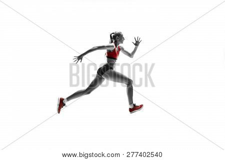 The One Caucasian Female Silhouette Of Runner Running And Jumping On White Studio Background. The Sp