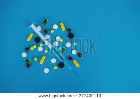 Medical Pills. Colored Pills And Capsule On Blue Background. Pharmacy Theme, Capsule Pills With Medi