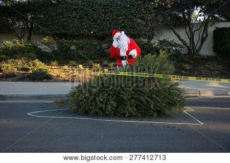 Sad Santa Claus. Santa Claus wipes away a tear as Christmas comes to an end for the year. Santa Crying. Santa is Sad.