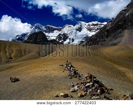 Stone Cairns On The Ausangate Trail In Peru