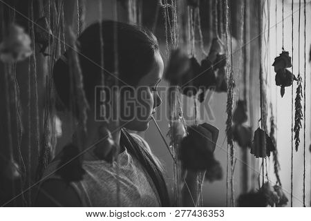 Little Girl With Flower Decor In Floral Shop. Child With Roses In Florist Shop, Floristry. Valentine