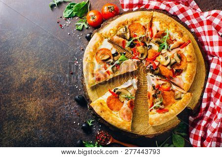 Traditional Italian Pizza, Vegetables, Ingredients On A Dark Background. Pizza Is Cooking In The Ove
