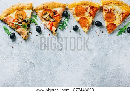 Slices Of Pizza With Prosciutto And Rocket Salad With Spices On Light Background. Pizza Is Cooking I