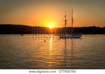 Sailboats Silhouetted Against Sunrise - Maine, Usa