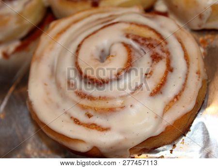 Closeup Of Iced Cinammon Roll Dessert On Pan