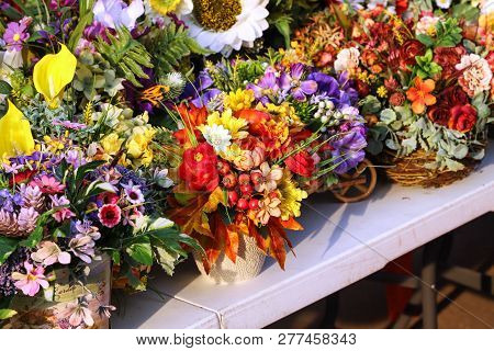 Summer Flower Arrangements On The Counter Of The Fair