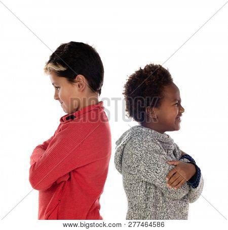 Two angry brothers back to back isolated on a white background