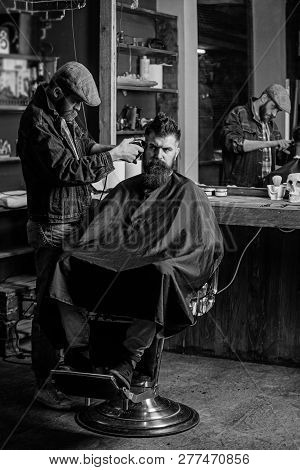Hipster Client Getting Haircut. Barber With Clipper Trimming Hair On Temple Of Client. Barber With H