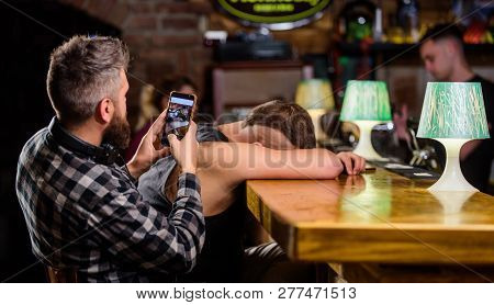 Hipster Making Fun Of Drunk Friend. Man Drunk Fall Asleep And Guy With Smartphone. Hipster Taking Ph