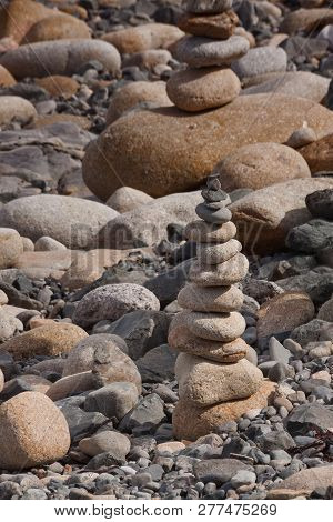 Pile Of Beach Pebbles Balancing On A Beach