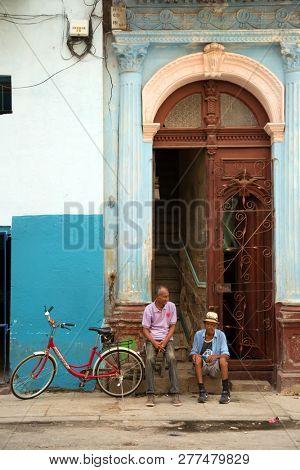 HAVANA-CUBA- DEC 5, 2018: Friends talking in the street of Centro Habana the smaller municipality of Havana, and the highest population density in Havana in Cuba