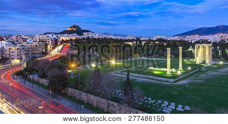 Aerial Panoramic View With Ruins And A Columns Of The Temple Of Olympian Zeus, Mount Lycabettus At N