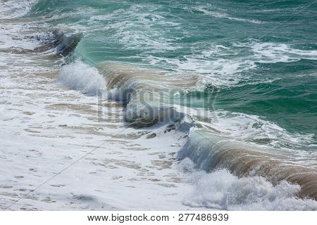 Ocean Waves On A Sandy Beach In Summer
