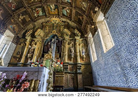 Celorico Da Beira, Portugal - July 20, 2018:  Detail Of The Main Chapel With A Magnificent Altarpiec