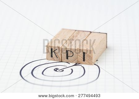 Key Performance Indicator, Kpi Concept, Small Wooden Stamp Combine The Acronym Kpi With Hand Draw Ar