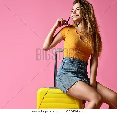 Traveler Tourist Woman In Summer Casual Clothes With Travel Suitcase Isolated On Pink Background. Tr