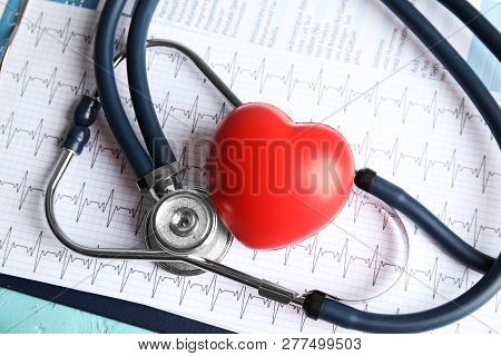 Stethoscope, Red Heart And Cardiogram On Table. Cardiology Concept