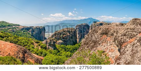 Meteora, Greece - June 16, 2013: Panoramic View On Scenic Meteora Landscape Rock Formations With Mon