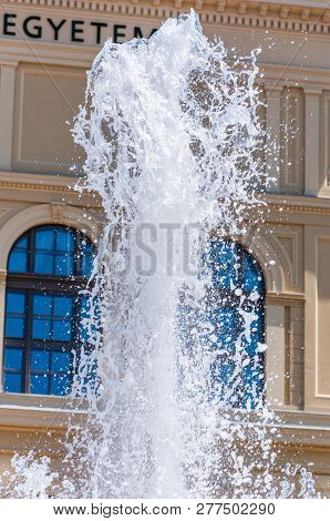 Szeged, Hungary - June 18, 2013: Frozen Fountain Stream In The Front Of The University Of Szeged. Th