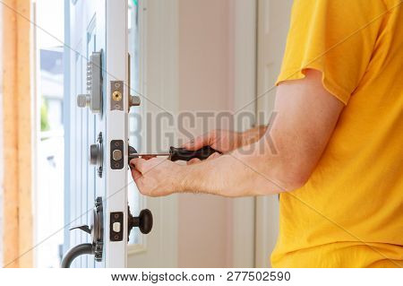 Worker Installing Or Repairing New Lock Handyman Repair The Door Lock