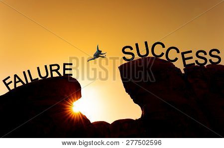 Silhouette A Man Jumping Over Precipice From Failure To Success.business Success, Challenge, Achieve