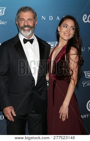 LOS ANGELES - JAN 5:  Mel Gibson, Rosalind Ross at the Art of Elysium 12th Annual HEAVEN Celebration at a Private Location on January 5, 2019 in Los Angeles, CA