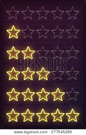 Set Of Yellow Neon Stars Rating Design Elements Isolated On Dark Brick Wall. Vector Kit Of Neon Star