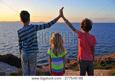 Three Kids Standing By The Sea, Naxos, Greece