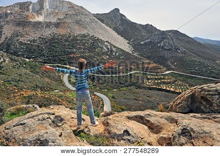 Teenage Standing In Mountains With Open Arms