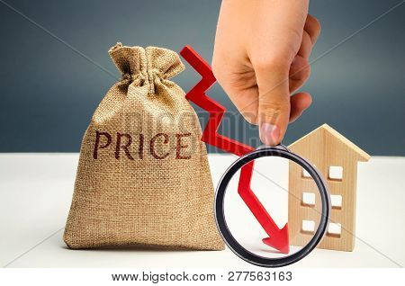 Money Bag With Word Price, Down Arrow And Wooden House. The Concept Of Falling Property Prices. Lowe