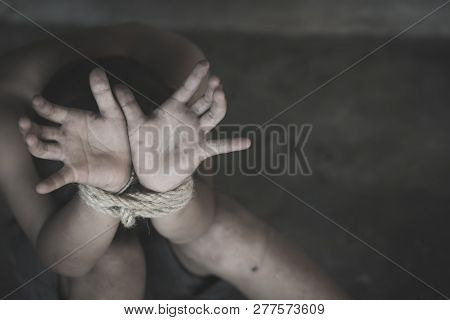 The Child Is Bound By A Rope, Stop Child Violence And Trafficking. Stop Violence Against Children, C