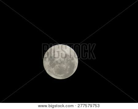 Save Download Preview  Full Super Moon Over Dark Black Sky At Night. Full Moon Background.