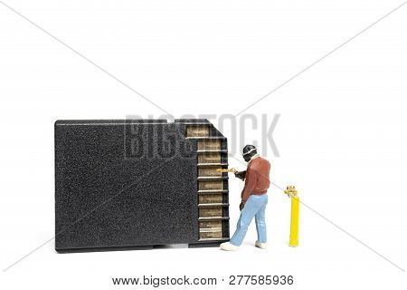 Miniature People Technician Fixing Pile Of Sd Cards On White Background