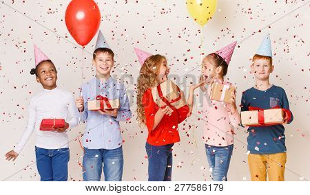 Kids Celebrating Birthday Party Together Over Light Background