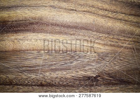 Vintage Wooden Cutting Board With Scratches And Vignette. Image Shot From Above In Flat Lay Position