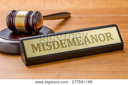 A Gavel And A Name Plate With The Engraving Misdemeanor