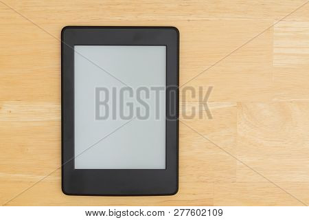 A Blank E-reader On A Desk That You Can Use As A Mock Up For Your Message