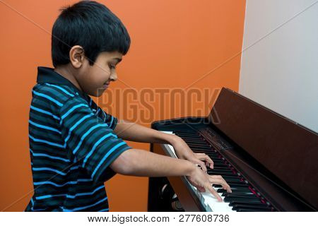 a young passionate musician playing the piano