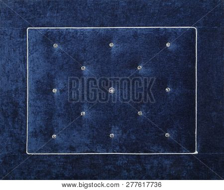 Close up background of dark navy blue color soft velvet bed headboard with rhinestone crystals, front view poster