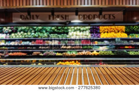 Panoramic view of vegetable stall counter in supermarket with copy space. Fruits and vegetables on store stand with supermarket grocery store blurred defocused background