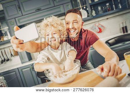 Jovial Gay Boy And Man Photographing Cooking