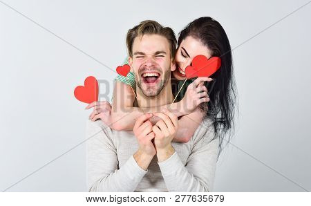 Romantic Ideas Celebrate Valentines Day. Man And Woman Couple In Love Hug And Hold Red Heart Valenti