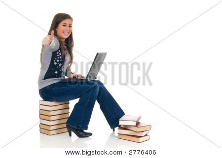 Teen Student Working On Laptop