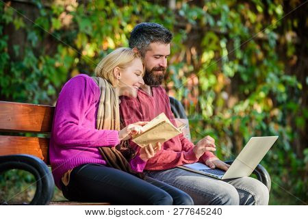 Use Digital Approach As Well As Books. Man And Woman Use Different Information Storage. Couple Spend