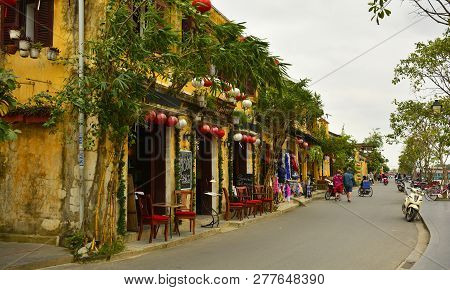Hoi An, Vietnam - December 20th 2017. Traditional Old Buildings Along The Hoi An Riverside Have Been